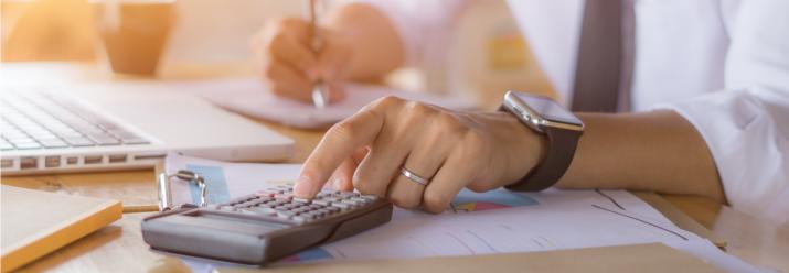 Man at desk calculator 2