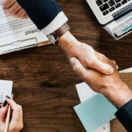Accountants shaking hands