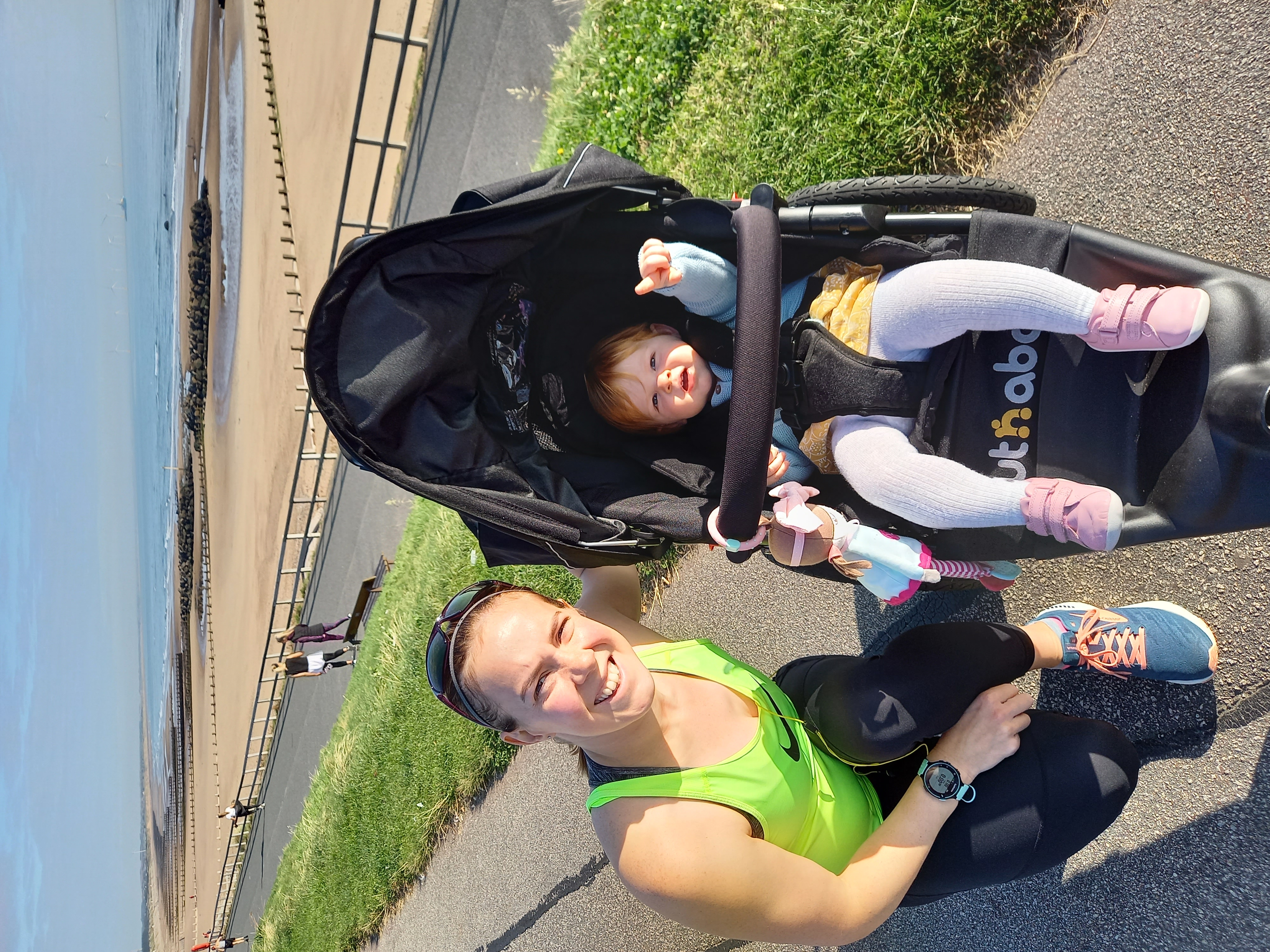 Eilidh with her daughter in her buggy