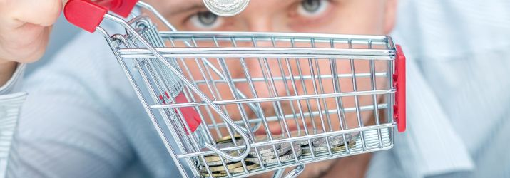 Picture of a shopping trolley filling with money