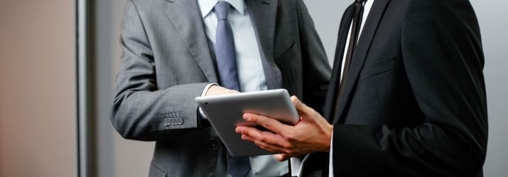 Businessmen with tablet