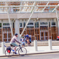 Cyclist in front of Scottish Parliament