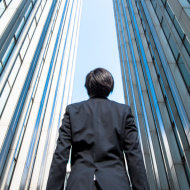 Photo of a businessman between two skyscrapers