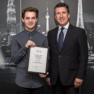 Timen Siret receives the Helen Jones bursary from Anton Colella