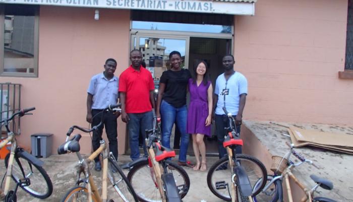 Olivia Ng with the bamboo bike social enterprise team