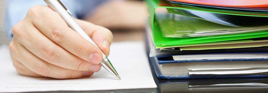 Man writing a document