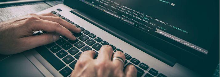 Computer hacker hands typing