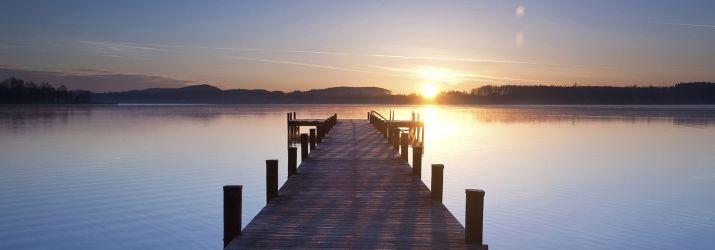Sunrise over a pier photo