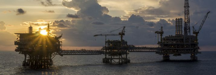 Offshore oil rigs during sunset