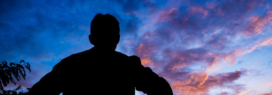 Picture of man looking at the sunrise