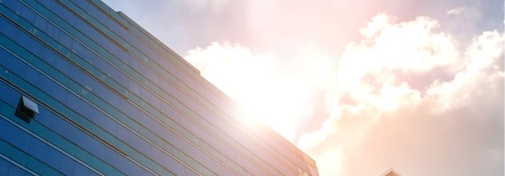Skyscraper against sunny sky