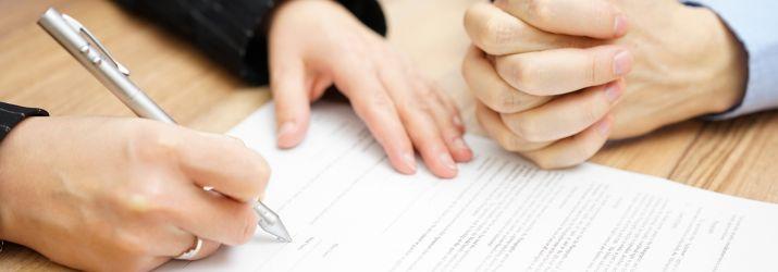 Couple signing document