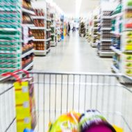 A photo of a trolley speeding through a supermarket