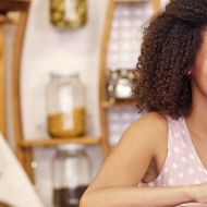 Coffee shop woman on laptop small business owner sme