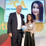 Hamisha Mehta receives the One Young CA Awards from ICAS President Mike McKeon