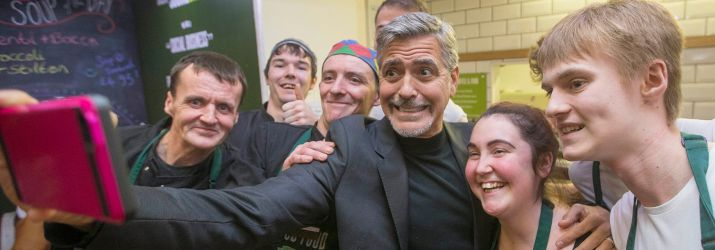 George Clooney taking selfie with Social Bite team