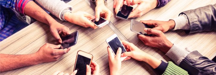 Mobile phones and apps around a table