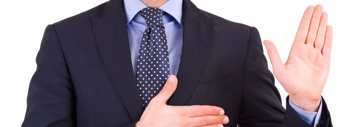 A businessman with his hand on his heart