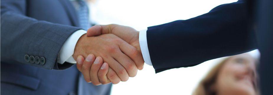 Handshake business men suits
