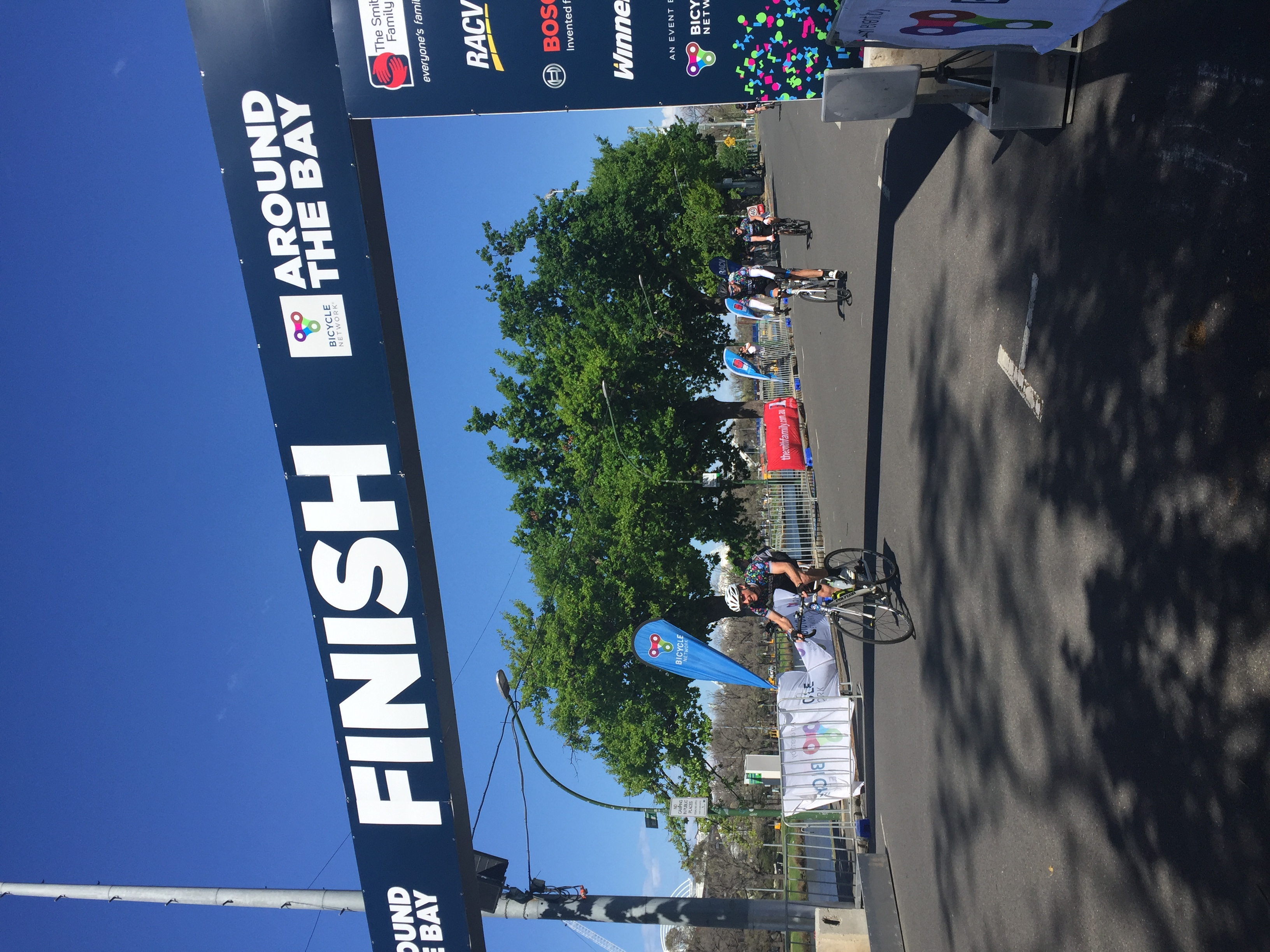 Jim McDonald cycling across the finish line