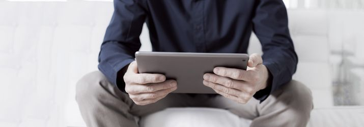 Man sitting using iPad