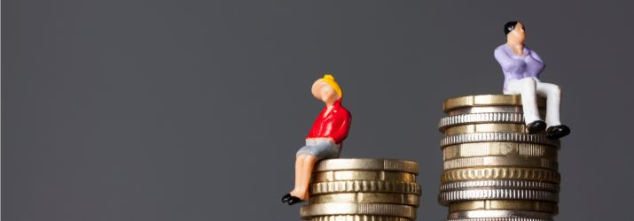 Gender pay gap figures sitting on coins ew