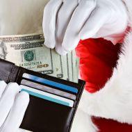 Santa holding money